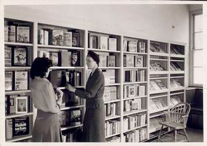 Librarian with young reader in... Digital ID: 1151145. New York Public Library