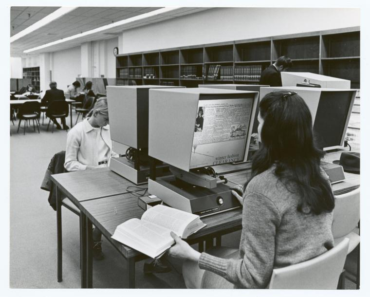 [Mid-Manhattan, Users at the microfilm viewers], Digital ID 1252841, New York Public Library