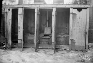 Row of outhouses Digital ID: 1583597. New York Public Library