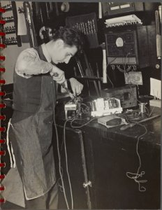 [student repairing a radio] Digital ID: 3926023. New York Public Library