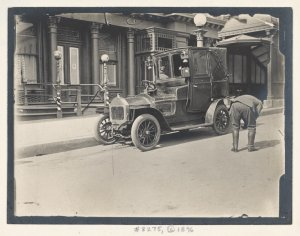 Taxi driver inspecting his veh... Digital ID: 79765. New York Public Library