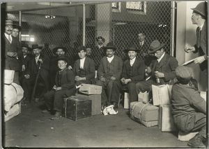 Group waiting at Ellis Island Digital ID: 79881. New York Public Library