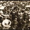 Photographer in a crowd, ca 1910.