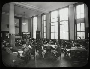 135th Street, children at tables in Children's reading room