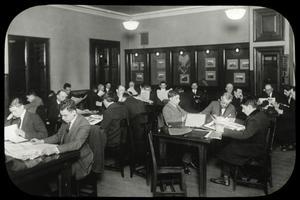 Rivington Street, men fill the reading room at night