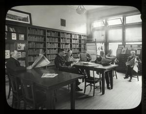 Webster: Interior views, men reading Czech magazines and newspapers