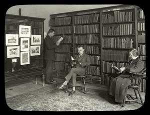 Webster: Interior views, Three readers in the Czech reference corner,, exhibit case at right
