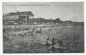 On the Float, Midland Beach, Staten Island, N.Y.  [people on float in water, buildings on shore, ferris wheel in distance.]