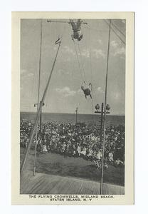 The Flying Cromwells, Midland Beach, Staten Island, N.Y.  [close up of trapeze performers on boardwalk, audience in background.]