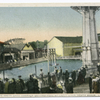 The Happy Land Sanitary Bathing Pool at Happy Land, South Beach, Staten Island. [(pool, diving platform, roller coaster in background.]