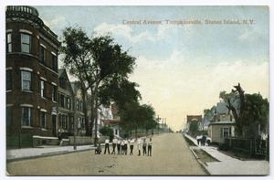 Central Avenue, Tompkinsville, Staten Island, N.Y. [residential street with row homes and interesting 3-story brick apt.? building; people walking on street and ten children posed in a line in street]