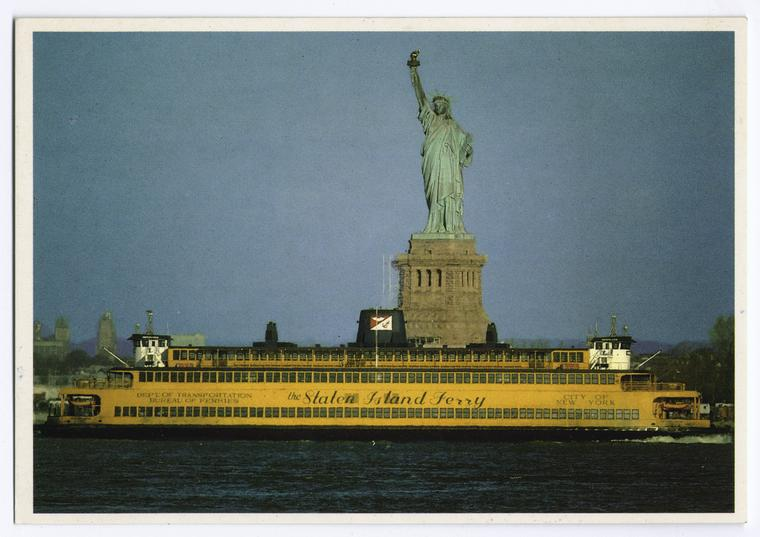 Statue of Liberty with Staten Island Ferry in foreground