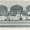 Benin city to-day: Bini chiefs sitting outside their new court house, opp. p. 68