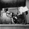 Grant Mills (wearing cap) as Jerry Hyland, Jean Dixon (seated) as May Daniels, Hugh O'Connell (seated) as George Lewis and Oscar Polk as the porter.