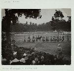 Garebeg [Festival]. Blow-up of photograph on preceding page. [Gladi resik: rehearsal of parade of keraton troops on the southern alun-alun preceding the celebration of Garebeg. Yogyakarta, 1935]