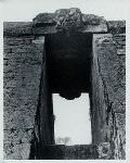Sukuh, candi. Entrance gate with Kala head of Thandi Sukuh on Mt. Lawu, east of Surakarta, 15th century. Photo: Allen Atwell, 1962