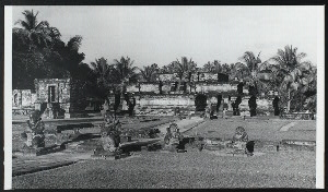 Java, East: Antiquities. Panataran, candi. Panataran principal temple, 1347 A.D., and before it, monumental guardian figures. To the left is the naga temple. Photo: Allen Atwell.