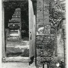Java, East: Antiquities. Sendangduwur. Gate post carved in stone with wooden carved door, at Muslim cemetery at Sendangduwur. Photo: D.P. 6762, list #190.
