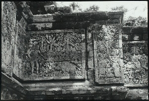Java, East: Antiquities. Surawana, candi. Tjandi Surawana: Ardjuna (?) with the boar on horizontal panel, and a scene from Sri Tandjung on the vertical panel. Photo: Allen Atwell, 1962.