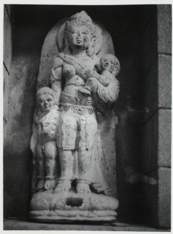 "Java, East: Antiquities. Miscellaneous. Royal female figure with two children. Ca. 24"" high. East Java. Coll. Museum Modjokerto. Photo: Frank Weinstein, 1969."