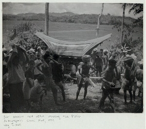 Bier bearers rest after crossing rice fields. Neg. C1039.