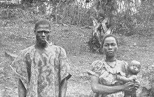 """ Papa, Maman, et bébé "" : A Grebo man, wife and child (Cape Palmas)."