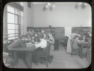Aguilar [Librarian with children gathered around table].