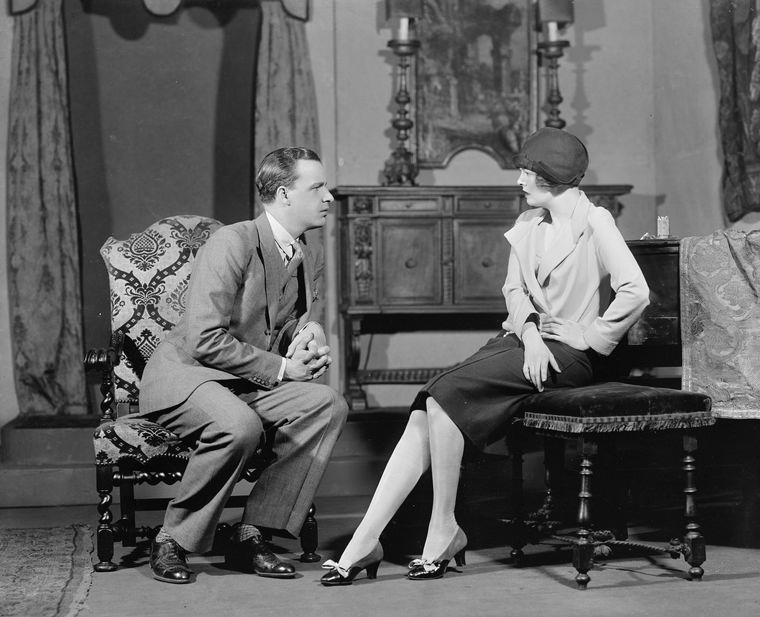 Alfred Lunt as Clark Storey and Margalo Gillmore as Monica Grey.