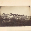 Jefferson Barracks. St. Louis, Mo.  Two long brick buildings, one with shutters at windows, garden and fence in foreground.]