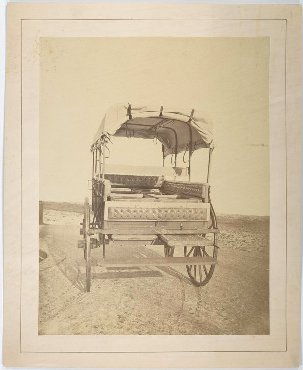 This is What United States Sanitary Commission and Howard ambulance rear view tailgate partially lowered rollers that support cushioned litters are visible. Background masked Looked Like  in 1861