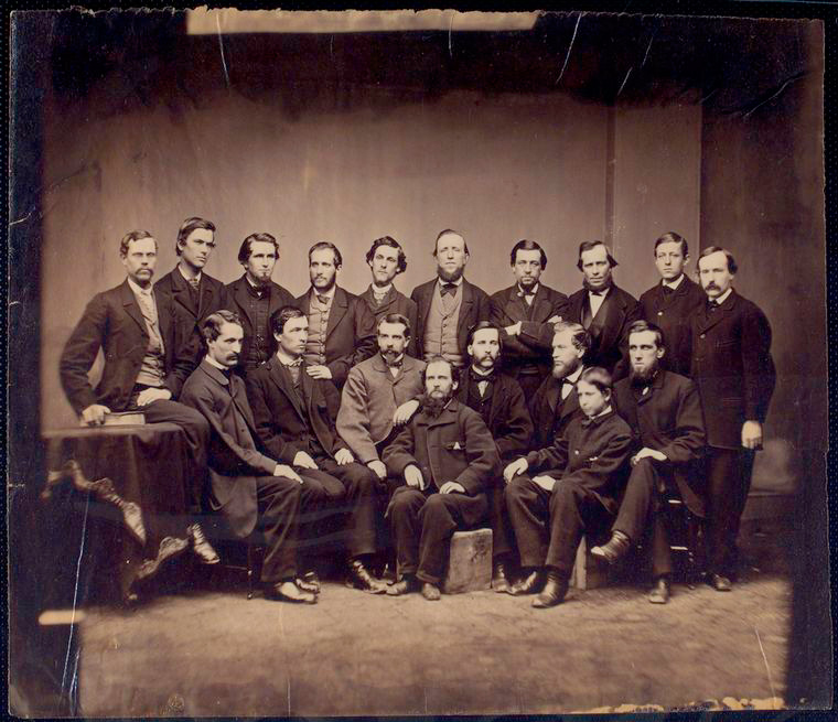 This is What United States Sanitary Commission and Group of USSC personnel; eight seated in front ten standing in rear Looked Like  in 1861