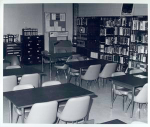 [Bookshelves, tables, chairs at the Dongan Hills Library