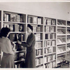 Librarian with young reader in Browsing Room of the Nathan Strauss Branch for Young People
