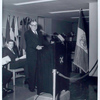 [Speaker at podium with WNYC mic, Fordham Branch.]