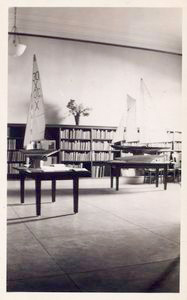 [Interior, model sailboats.]