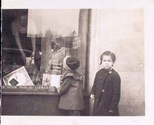 [Exterior, children looking in at window display.]