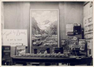 [Exterior, window display: Travel by Books and Not by Boat.]