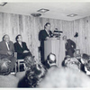 Grand Concourse Dedication: Mayor Wagner, speaking; (l-r) Commissioner Zurmuhlen; Mr. John Mackenzie Cory, Chief of the Circulation Department; Mr. Samuel P. Tolesano, Secretary to Borough President Lyons