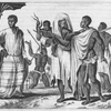 Men standing with woman holding child in her arms.]