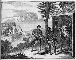 [Two men with drums talking to a man standing in entrance of dwelling.]