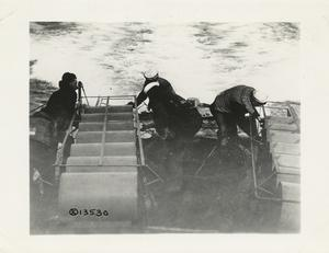 Untying depth bombs at sea. Taken aboard United States Steamship [?] Whipple. May 18, 1918.
