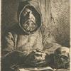 Tête de moine en prière.