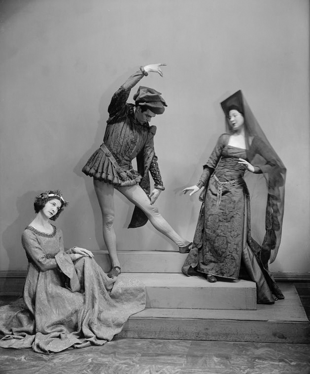 "Charles Weidman, Eugenia Liczbinska with Blanche Talmud (seated) Dance Group appearing in music-dance-drama ""Music of the troubadours"" (Neighborhood Playhouse Production, New York, 1931)"