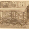 [A wagon with signs promoting single tax.]