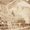 Construction of the skeleton and plaster surface of the left arm and hand of the Statue of Liberty.]