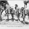 Women of the interior returning from the gardens with cassava and firewood.
