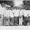 Fang Christians.  In the middle of the front row stands Amvama.  Behind him, on his right, is Ndong Koni.  The tall young man is Robert Boardmen, the blind catechist.