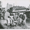 Group of freedmen, including children, gathered by a canal in Richmond, Virginia
