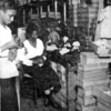 A Negro doll factory in Harlem which provides colored dolls for Negro children