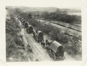 [Wagon train on a road.]